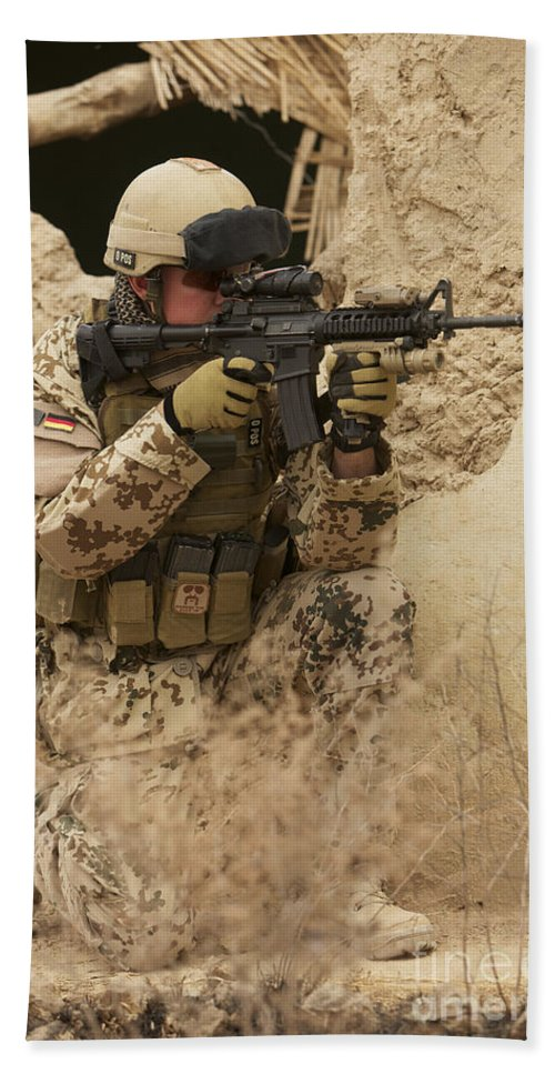 Looking Through Beach Towel featuring the photograph A German Army Soldier Armed With A M4 by Terry Moore