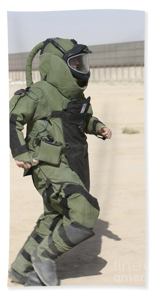 Explosive Ordnance Disposal Beach Towel featuring the photograph A U.s. Marine Tries Running In A Bomb by Terry Moore