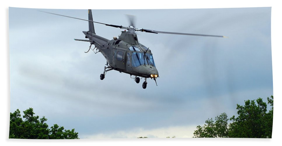 Helicopter Beach Towel featuring the photograph An Agusta A109 Helicopter by Luc De Jaeger