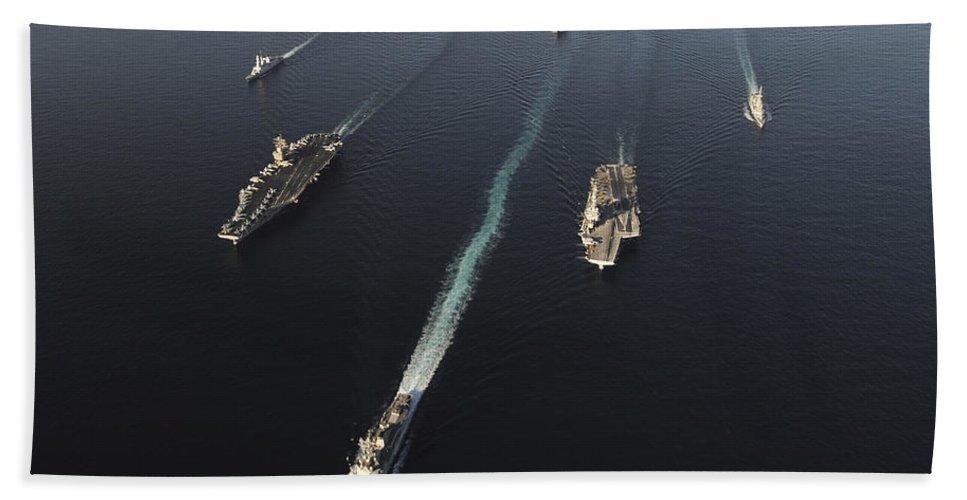 Horizontal Beach Towel featuring the photograph Fleet Of Navy Ships Transit The Arabian by Stocktrek Images