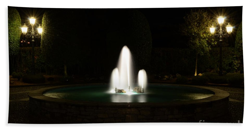 Fountain Beach Towel featuring the photograph Fountain At Night by Mats Silvan