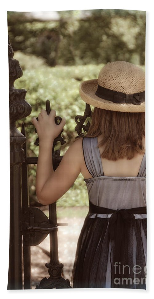 Girl Beach Towel featuring the photograph Girl Looking Over Iron Gate by Jill Battaglia