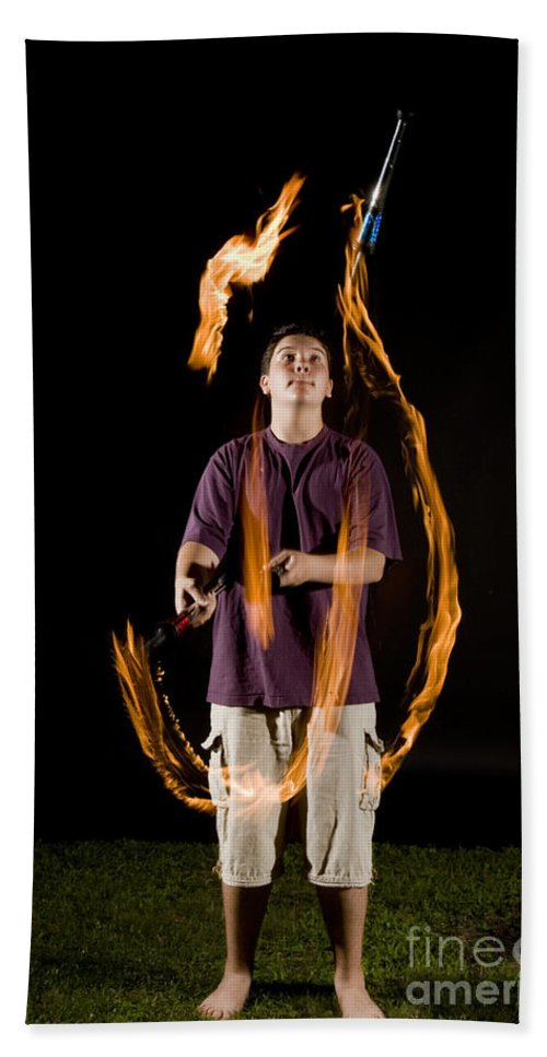 Flame Beach Towel featuring the photograph Juggling Fire by Ted Kinsman