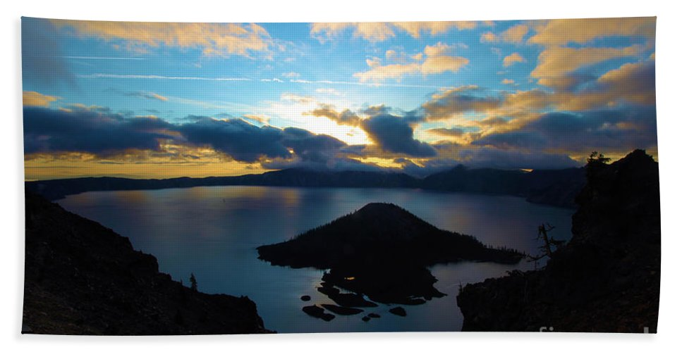 Crater Lake National Park Beach Towel featuring the photograph Sunrise Over The Wizard by Adam Jewell