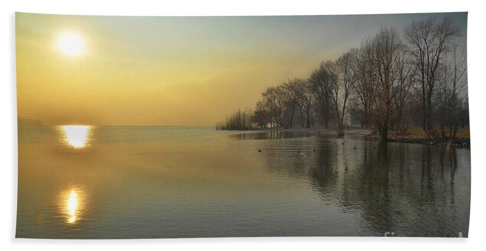 Sunshine Beach Towel featuring the photograph Sunshine Over A Lake by Mats Silvan