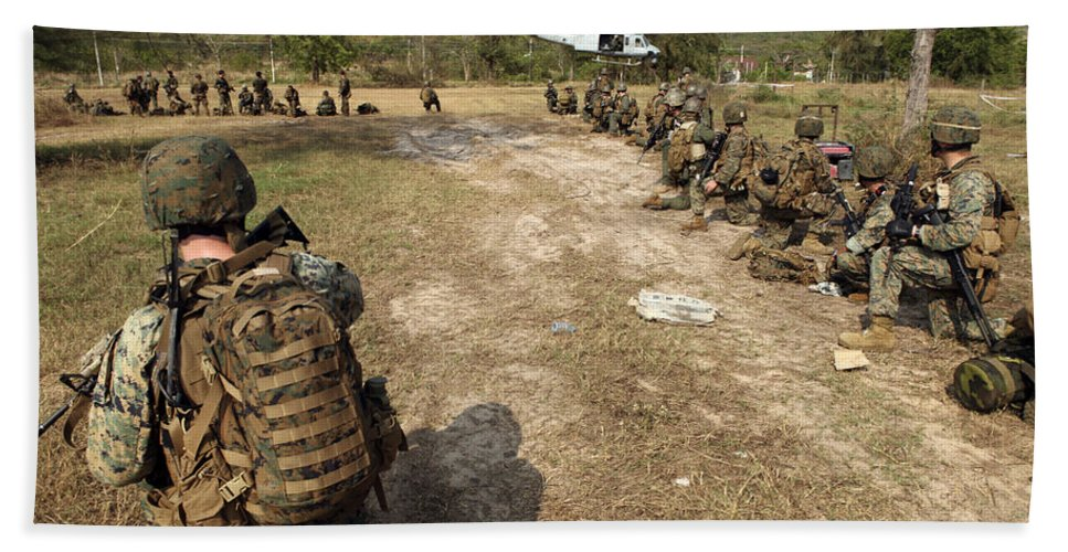 Marine Expeditionary Unit Beach Towel featuring the photograph U.s. Marines Provide Security by Stocktrek Images