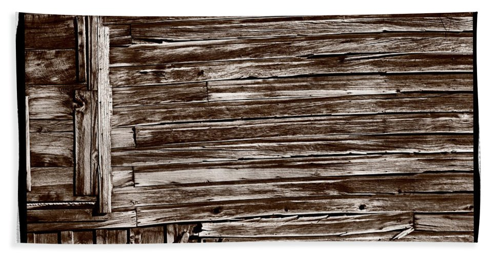 Black Beach Towel featuring the photograph Weathered Wall In Bodie Ghost Town by Steve Gadomski