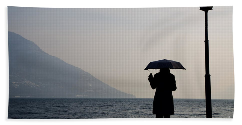 Woman Beach Towel featuring the photograph Woman With An Umbrella by Mats Silvan