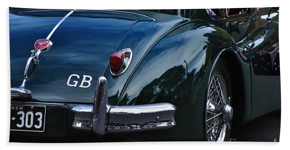 Photography Beach Towel featuring the photograph 1956 Jaguar Xk 140 - Rear And Emblem by Kaye Menner