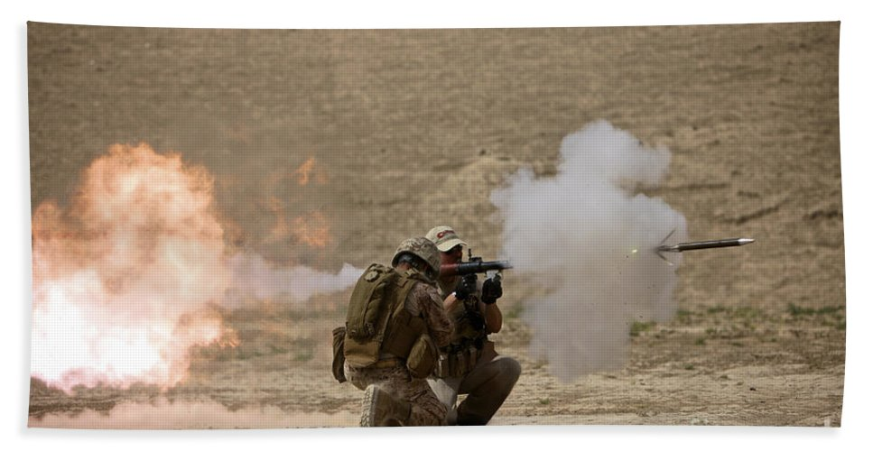 Operation Enduring Freedom Beach Towel featuring the photograph A U.s. Contractor Fires by Terry Moore
