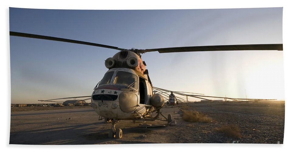 Aviation Beach Towel featuring the photograph An Iraqi Helicopter Sits On The Flight by Terry Moore