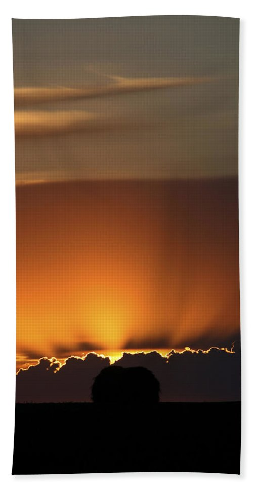 Sun Beach Towel featuring the photograph Setting Sun Peaking Out From Storm Clouds In Saskatchewan by Mark Duffy