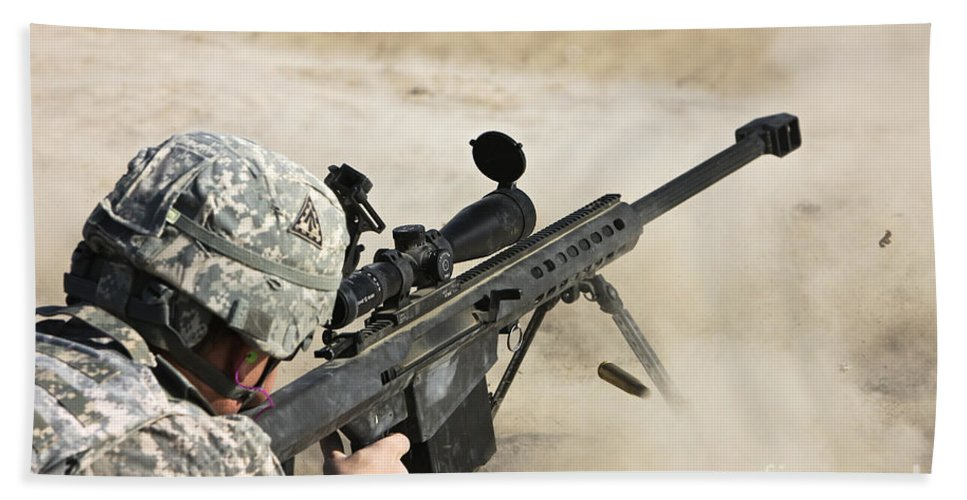 Sniper Beach Towel featuring the photograph U.s. Army Soldier Fires A Barrett M82a1 by Terry Moore