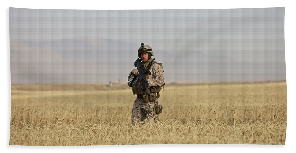 Patrol Beach Towel featuring the photograph U.s. Marine Patrols A Wadi Near Kunduz by Terry Moore