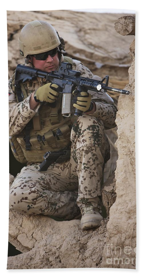 Sitting Beach Towel featuring the photograph A German Army Soldier Armed With A M4 by Terry Moore