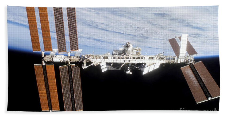 Blue Beach Towel featuring the photograph International Space Station by Stocktrek Images