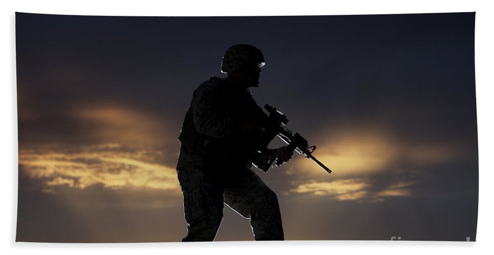Vigilant Beach Towel featuring the photograph Partially Silhouetted U.s. Marine by Terry Moore
