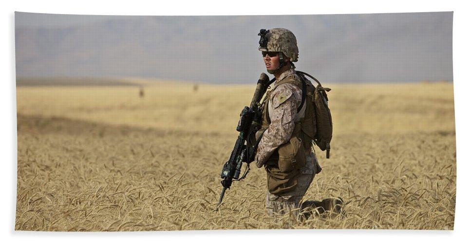 Afghanistan Beach Towel featuring the photograph U.s. Marine Patrols A Wadi Near Kunduz by Terry Moore