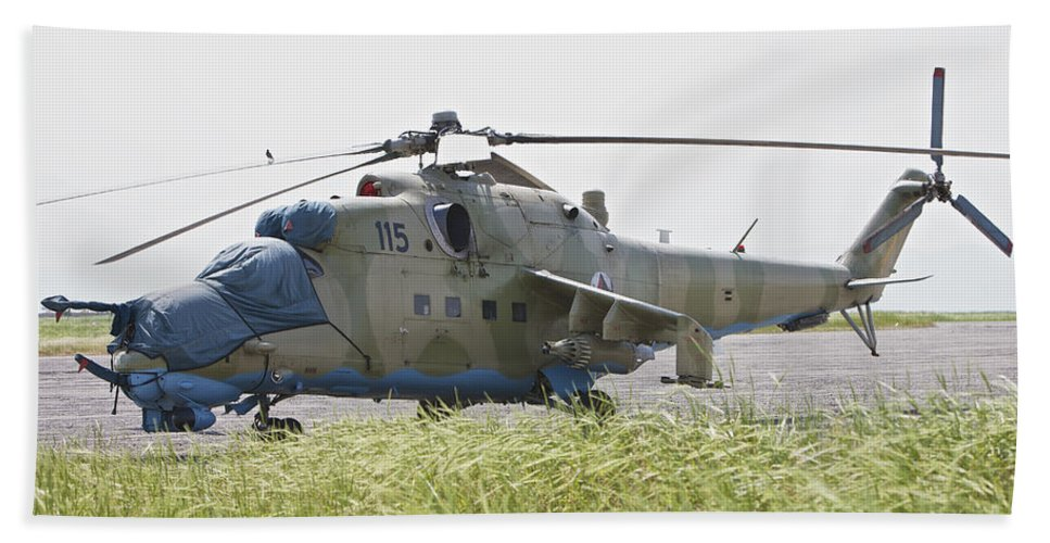 Rotary Wing Aircraft Beach Towel featuring the photograph An Mi-35 Attack Helicopter At Kunduz by Terry Moore