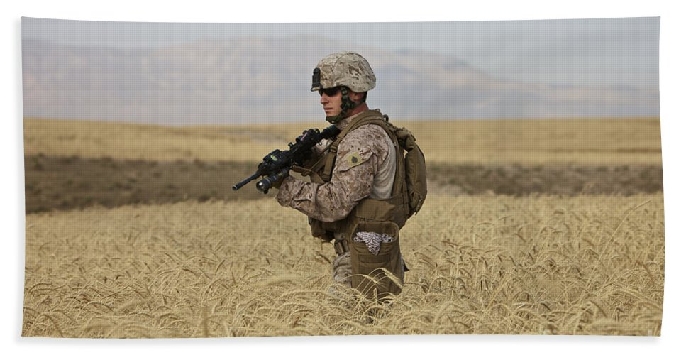 Us Marines Beach Towel featuring the photograph U.s. Marine Patrols A Wadi Near Kunduz by Terry Moore