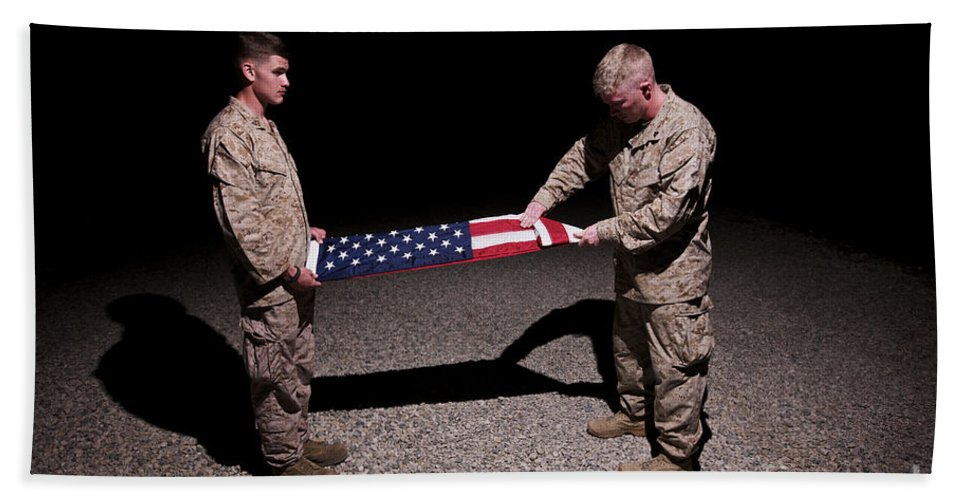 Night Beach Towel featuring the photograph U.s. Marines Fold The American Flag by Terry Moore