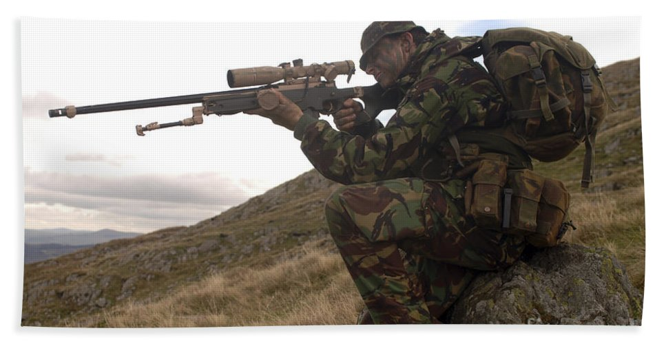 Foreign Military Beach Towel featuring the photograph A British Soldier Armed With A Sniper by Andrew Chittock