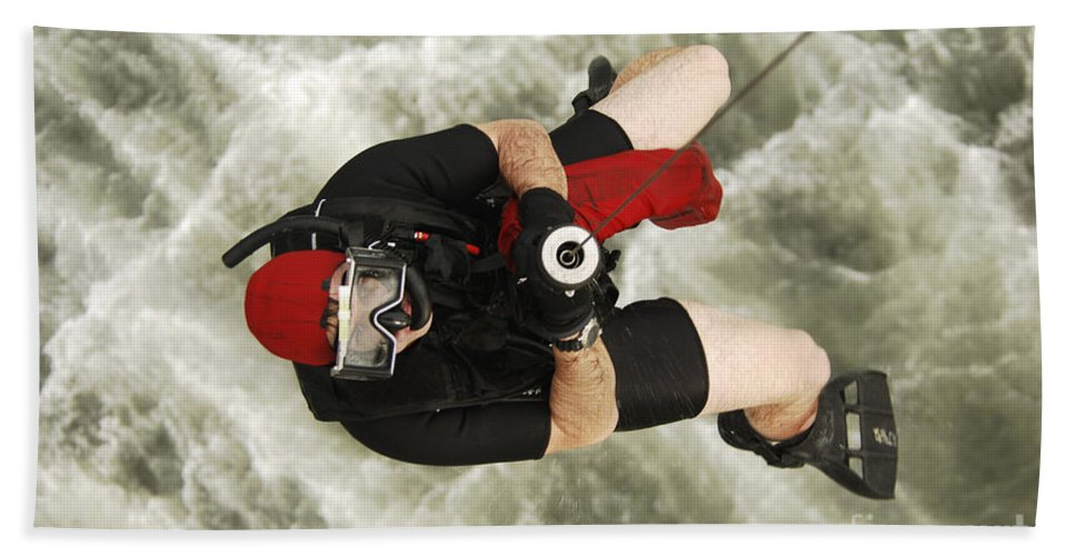 Color Image Beach Towel featuring the photograph A Diver Is Hoisted Aboard An Sh-60f by Stocktrek Images