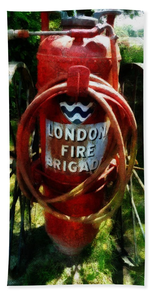 London Fire Brigade Beach Towel featuring the photograph A Foamite Model F2 Chemical Fire Estinguisher by Steve Taylor