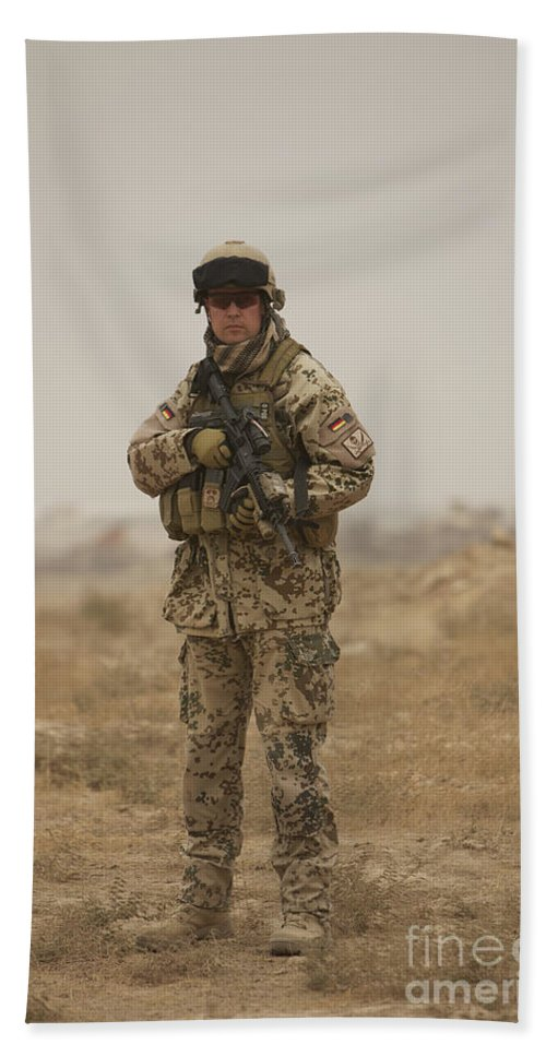 Operation Enduring Freedom Beach Towel featuring the photograph A German Army Soldier Armed With A M4 by Terry Moore