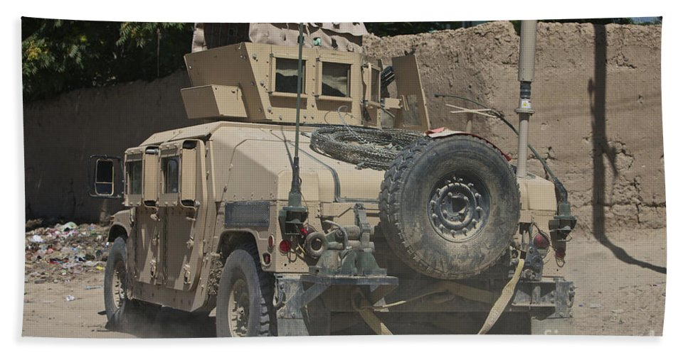 Hmmwv Beach Towel featuring the photograph A Humvee Patrols The Streets Of Kunduz by Terry Moore