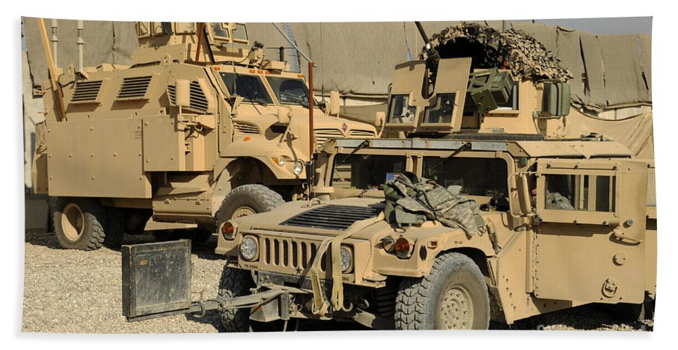 Horizontal Beach Towel featuring the photograph A M1114 Humvee Sits Parked In Front by Stocktrek Images