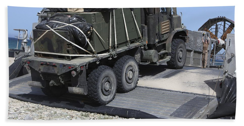 Horizontal Beach Towel featuring the photograph A Medium Tactical Vehicle Replenishment by Stocktrek Images