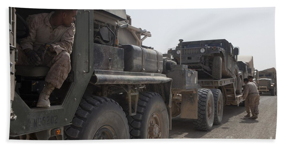 Convoy Beach Towel featuring the photograph A Mk48 Logistics Vehicle System by Stocktrek Images
