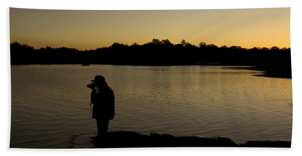 Pachmarhi Beach Towel featuring the photograph A Photographer At Work During Sunset Over A Lake by Ashish Agarwal