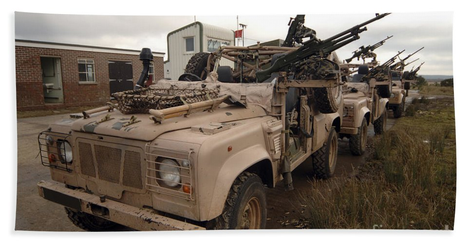 Foreign Military Beach Towel featuring the photograph A Pink Panther Land Rover by Andrew Chittock
