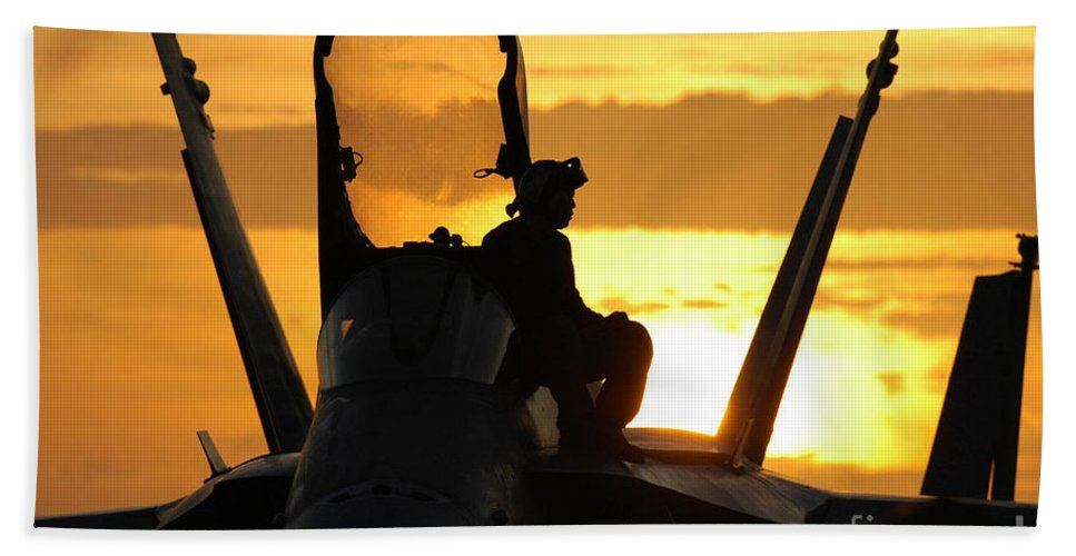 Horizontal Beach Towel featuring the photograph A Plane Captain Enjoys A Sunset by Stocktrek Images