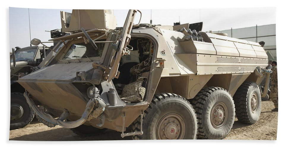Isaf Beach Towel featuring the photograph A Tpz Fuchs Armored Personnel Carrier by Terry Moore