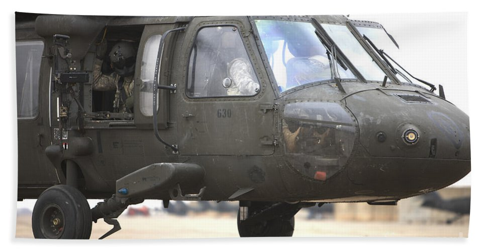 Aviation Beach Towel featuring the photograph A Uh-60 Black Hawk Taxis by Terry Moore