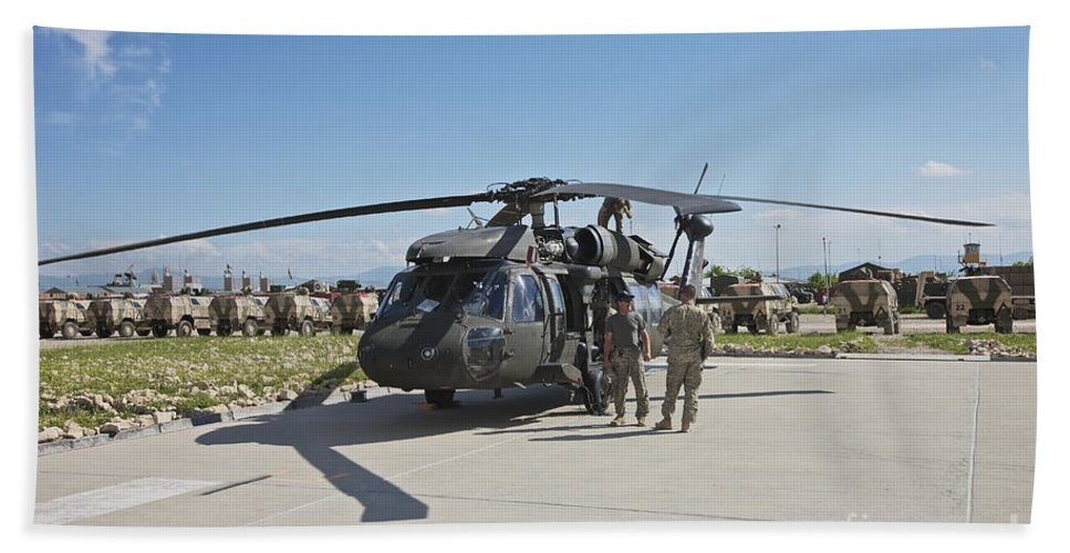 Operation Enduring Freedom Beach Towel featuring the photograph A Uh-60l Blackhawk Parked On Its Pad by Terry Moore