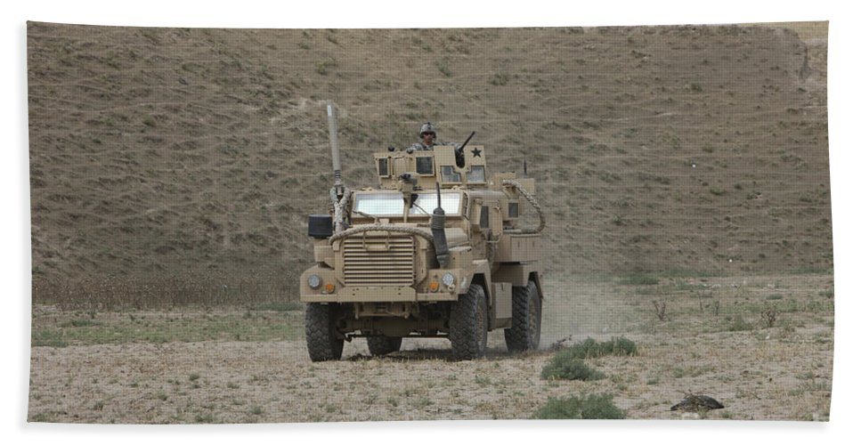 Mrap Beach Towel featuring the photograph A U.s. Army Cougar Patrols A Wadi by Terry Moore