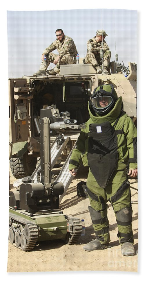 Kunduz Beach Towel featuring the photograph A U.s. Marine Dressed In A Bomb Suit by Terry Moore