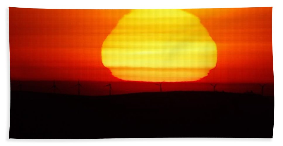 Sun Rise Beach Towel featuring the photograph A Wavering Sunrise by Jeff Swan