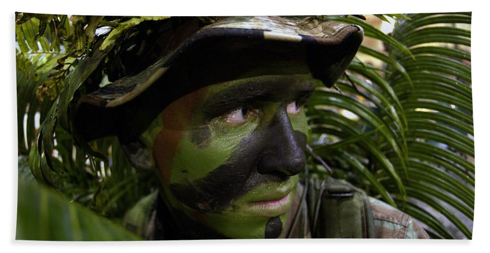 Black Beach Towel featuring the photograph Airman Conceals Himself By Blending by Stocktrek Images