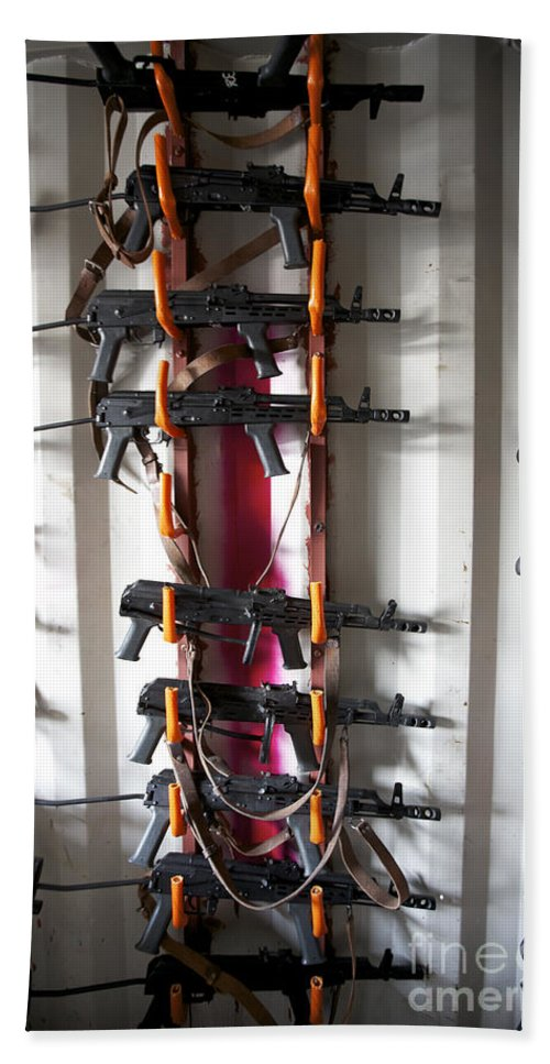 7.62mm Beach Towel featuring the photograph Akm Assault Rifles Lined Up On The Wall by Terry Moore
