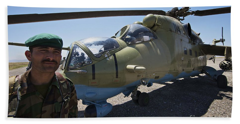 Mil Mi-35 Beach Towel featuring the photograph An Afghan Army Soldier Guards An Mi-35 by Terry Moore