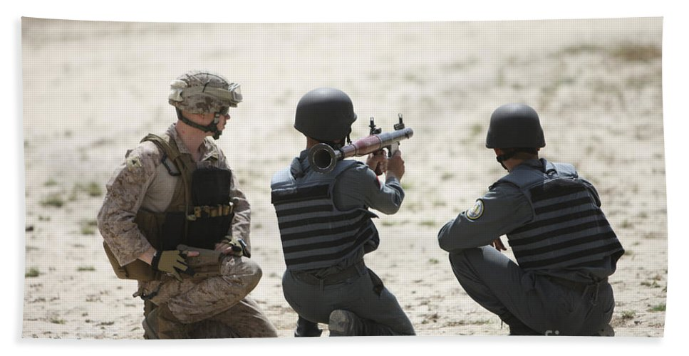 Afghanistan Beach Towel featuring the photograph An Afghan Police Student Prepares by Terry Moore