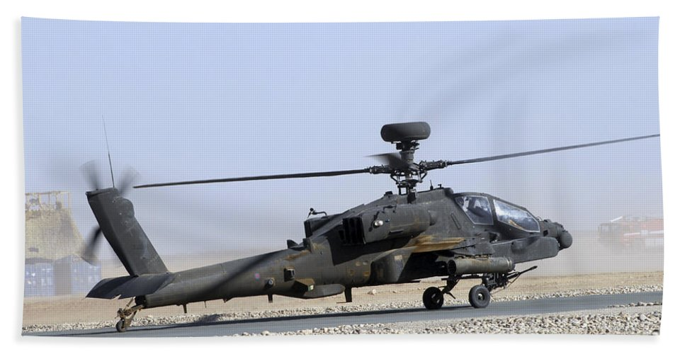 Aircraft Beach Towel featuring the photograph An Apache Helicopter Prepares by Andrew Chittock