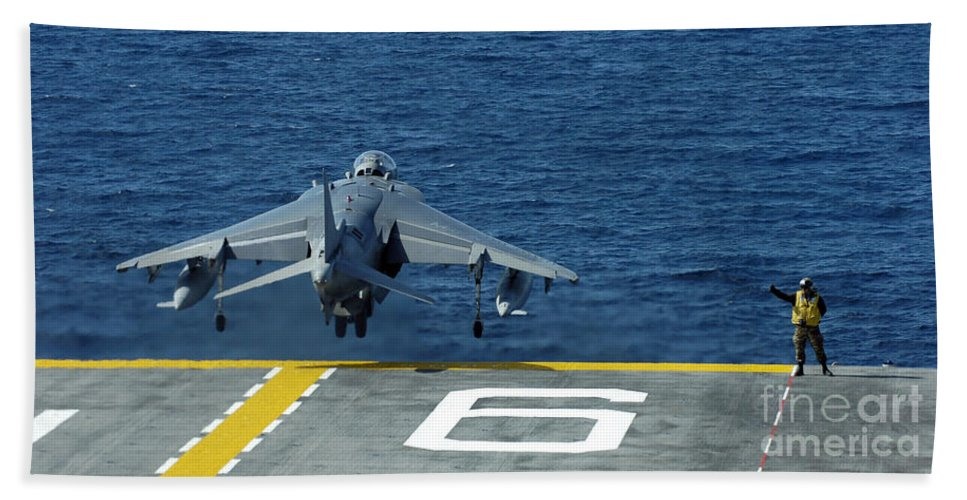 Vma-214 Beach Towel featuring the photograph An Av-8b Harrier II Launches From Uss by Stocktrek Images