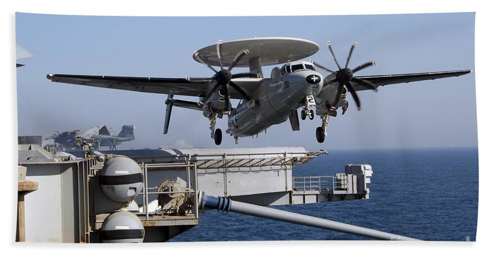 Uss Nimitz Beach Towel featuring the photograph An E-2c Hawkeye Launches Off The Flight by Stocktrek Images