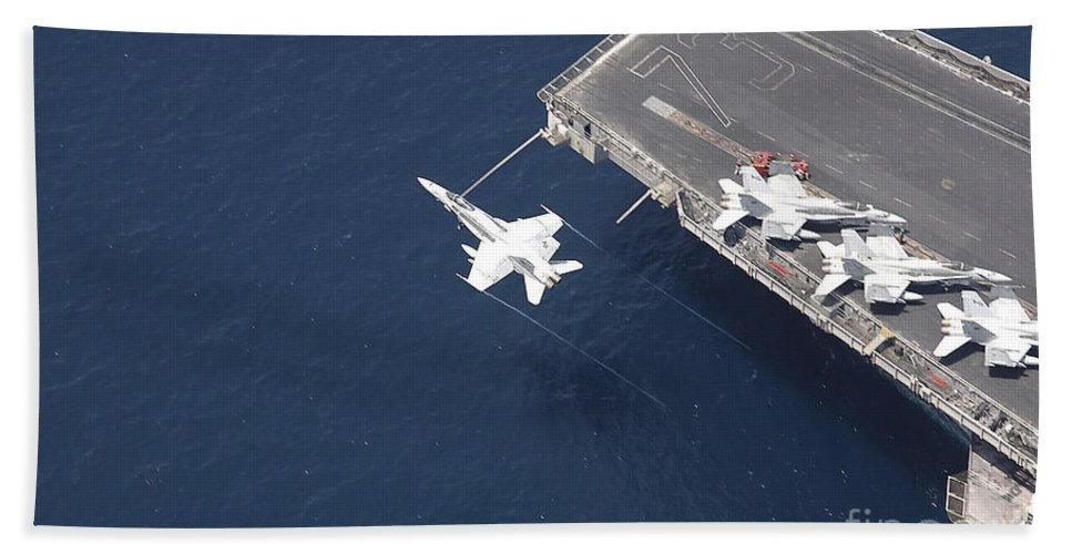 Horizontal Beach Towel featuring the photograph An Fa-18 Hornet Flys Over Aircraft by Stocktrek Images